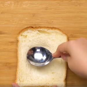 Use a spoon to squeeze the middle of the sandwich bread