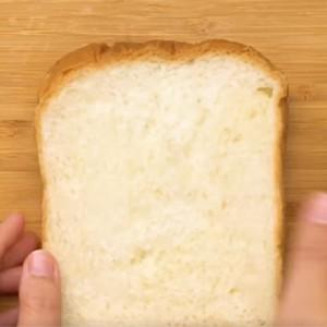 take another slice of sandwich bread to cover.