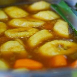 When the sweet potatoes become almost cooked, add the bananas