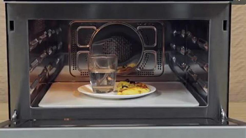 We can put a glass of water in the microwave while heating up the pizza