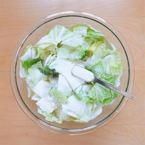mix cabbage pieces with salt into a large bowl