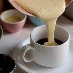 pour the mixture into the cup of coffe