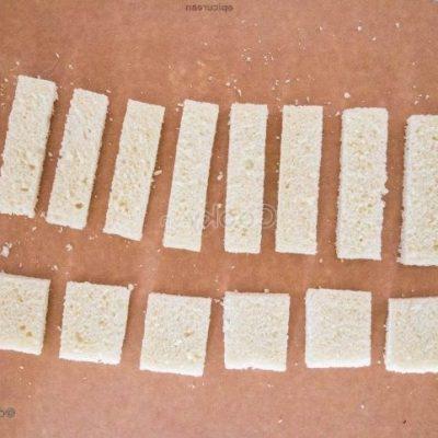 Cut sandwich slices into medium pieces