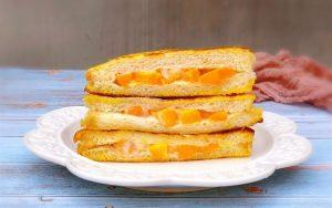 Fried sandwich stuffed with mango and yogurt