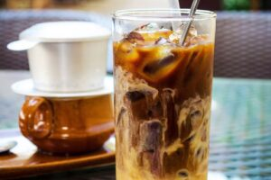 The attractive golden brown color of an iced coffee cup with milk