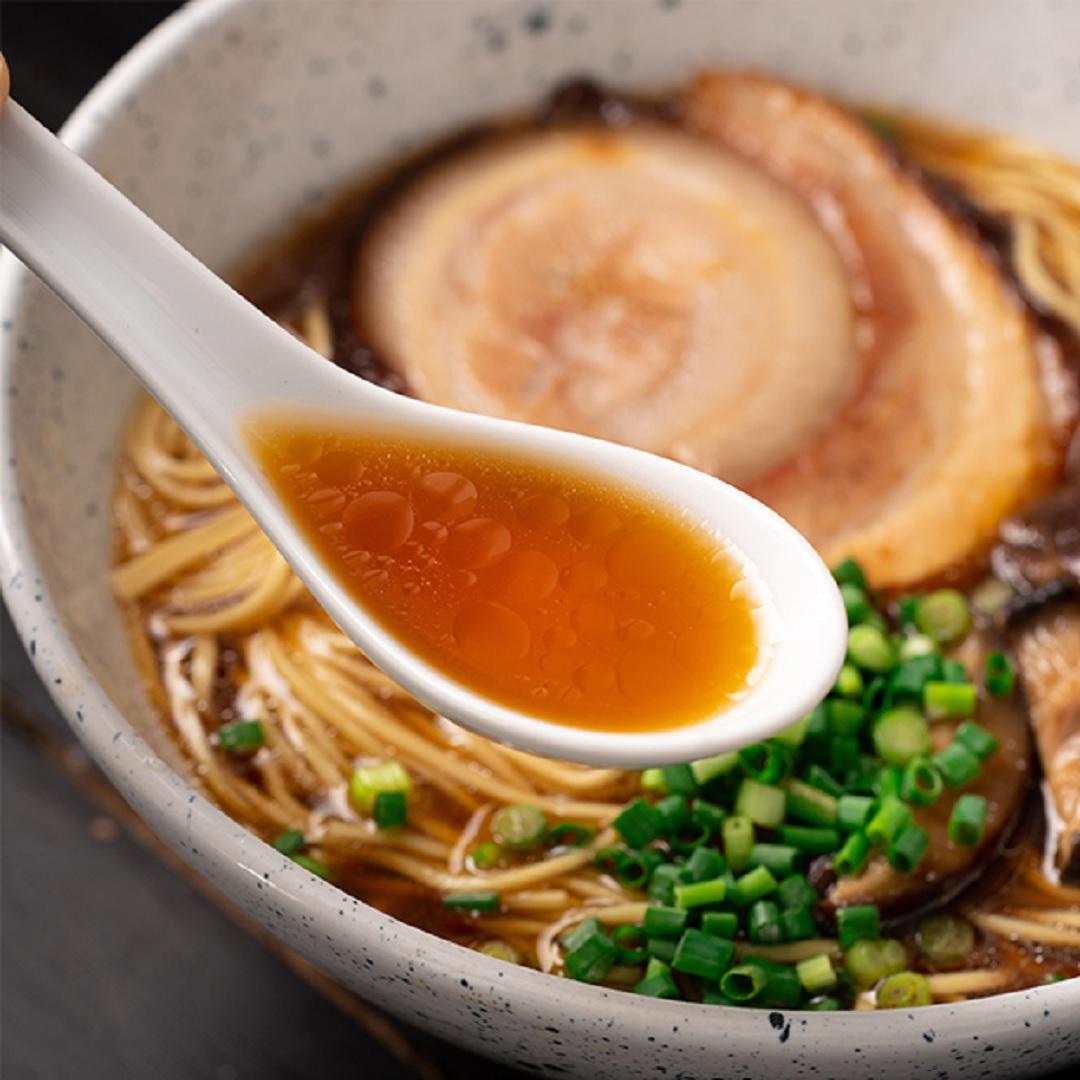 The classic shimmer-brown color of Shoyu Ramen soup